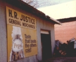 H R Justice store sign